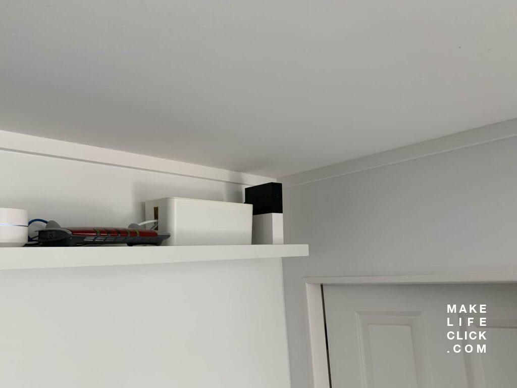Abode Security System Hub on an elevated shelf